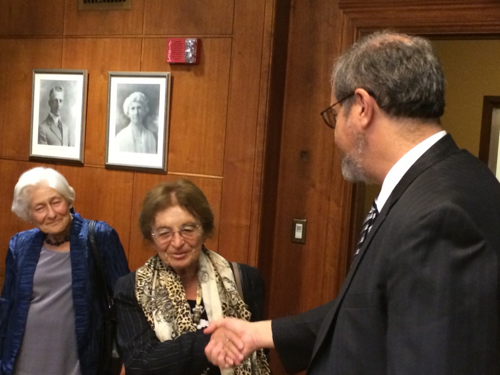Before the ceremony, Professor Emerita Irene Butter, co-founder of the Wallenberg Medal and Lecture and Holocaust survivor presented President Schlissel with a commemorative coin from the Wallenberg Congressional Ceremony earlier this summer.