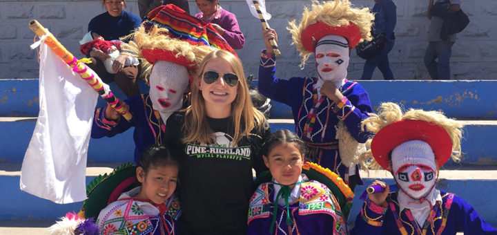 Maggie with children from Peru