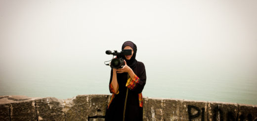 a woman, Safa Aden, with video camera